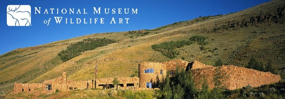 Jackson Hole Museum of Wildlife Ar.t The museum building with a grassy hill in the background.